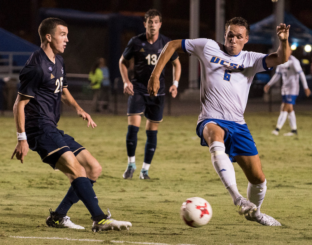 UCSB's Jan Ilskens contests a clearance by Akron defender Daniel Strachan. The Gauchos suffered a 3-1 loss.
