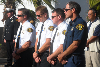 Santa Barbara County firefighters pause for a moment of reflection Tuesday. (Lara Cooper / Noozhawk photo)