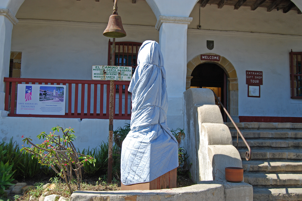 The statue of Junipero Serra at the Santa Barbara Mission is covered Monday after being vandalized.