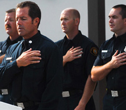 Local firefighters pay tribute Friday to those who died in the 9/11 terrorist attacks.