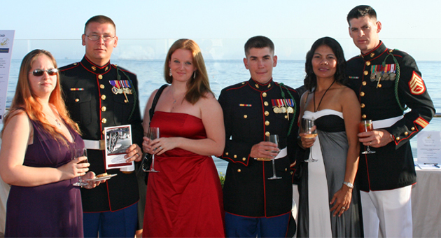 <p>Stephanie Madden-Clark, from left, and Sgt. Matthew Clark, Rebecca and Cpl. Adam Scott, and Sunee and SSgt. Jason Mayo enjoy the ocean view during a reception last Friday evening at the Coral Casino as part of the Santa Barbara Navy League&#8217;s Welcome Home Gala for the Marine Corps&#8217; 3rd Battalion, 5th Marines.</p>