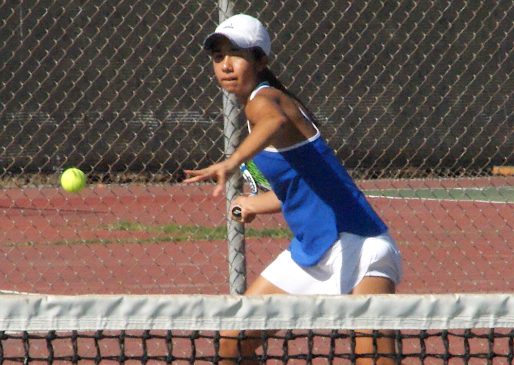 Yuka Perera of San Marcos prepares to hit a forehand in her No. 1 singles match against Mikala Triplett of Dos Pueblos.