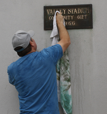 Volunteers have been scrubbing off years of grime and shining the letters of San Marcos High School's Vietnam War Memorial.