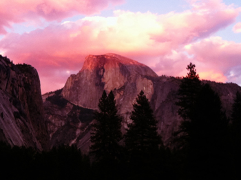 A dazzling sunset lights up the face of Yosemite's Half Dome.