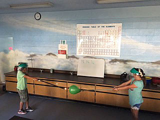 MCS upper elementary students work on a science experiment in Astrocamp lab.