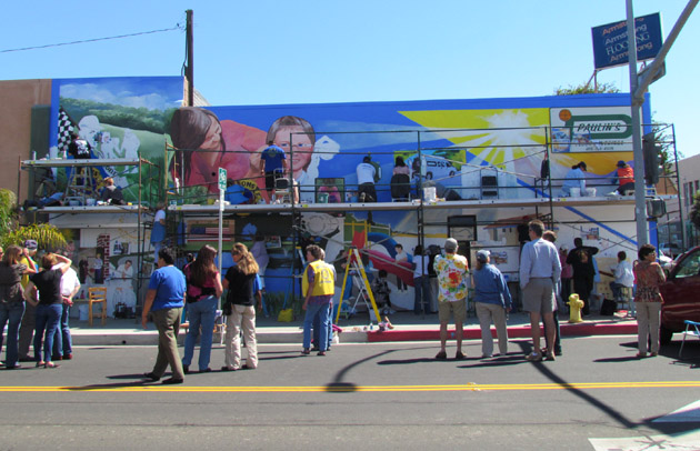 Mural project on the Paulin's Building at North I and West Ocean avenues in Lompoc takes shape Saturday to honor the city's historic service clubs. (Santa Barbara Foundation photo)