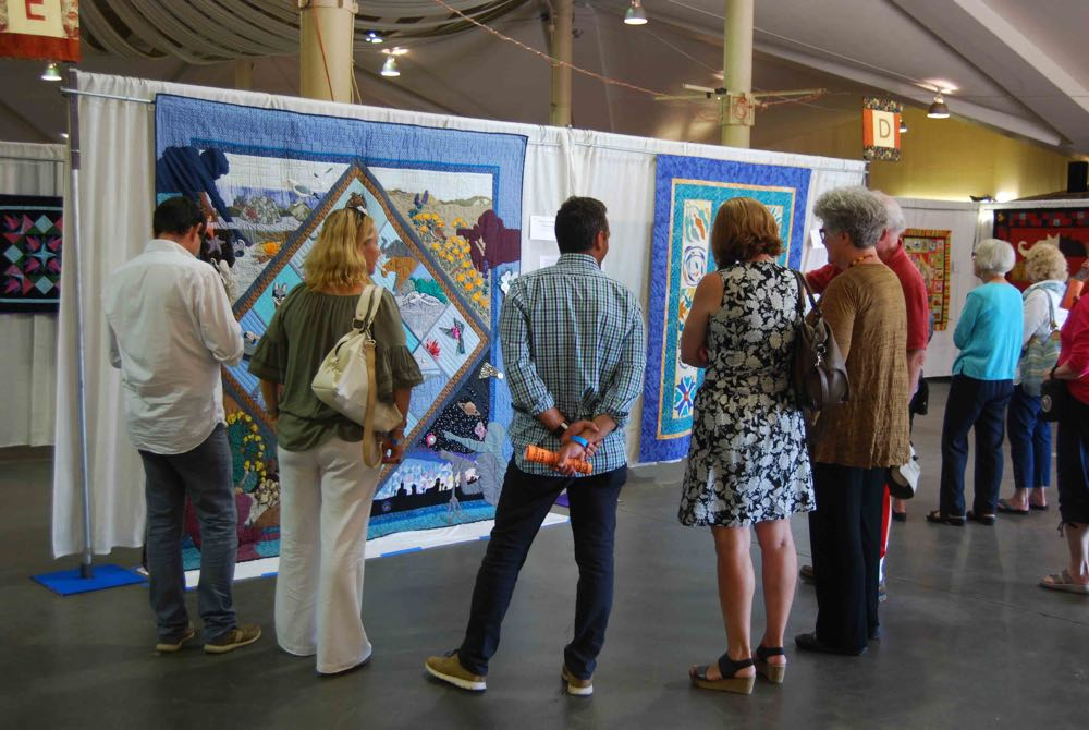 "Visitors view the ""Museum Impressions"" quilt, which was made in 1991 for the Santa Barbara Museum of Natural History."