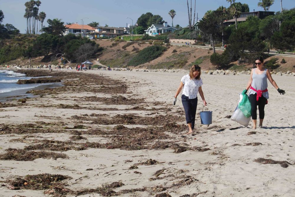International Coastal Cleanup Day volunteers Jamie Hartford, left, and Amy Dunphy pick up trash at Leadbetter Beach.