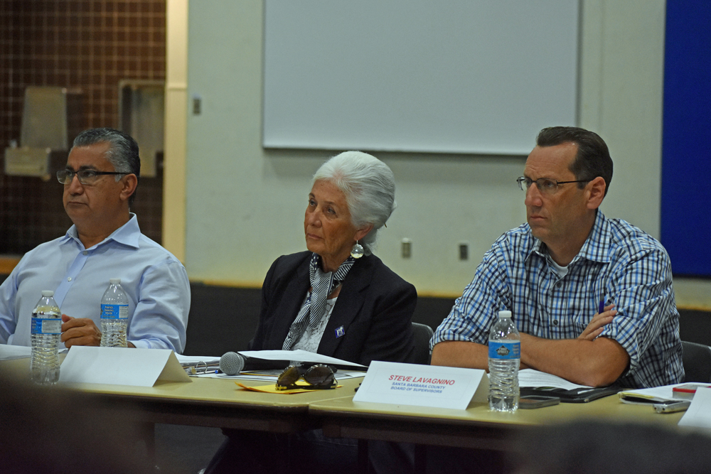 Mayor Alice Patino, sits between consultant Ernesto Olivares and Fifth District Supervisor Steve Lavagnino during the Mayor's Task Force on Youth Safety meeting Monday.