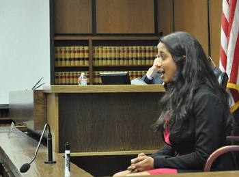 Co-captain Nimisha Shinday plays one of the star witnesses for the plaintiff's case as she portrays undercover reporter Tristan Frost. (DP Mock Trial photo)