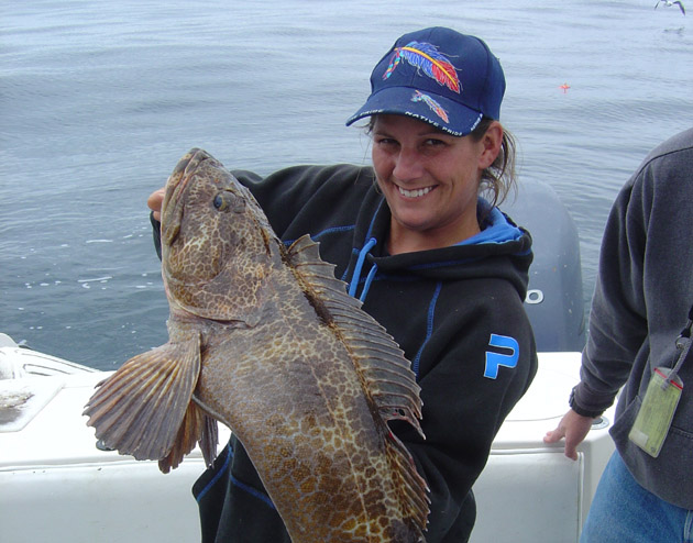 Capt. Tiffany Vague shows a lingcod that will feed an extended family and will be far fresher and tastier than anything from the grocery store. (Capt. David Bacon / Noozhawk photo)
