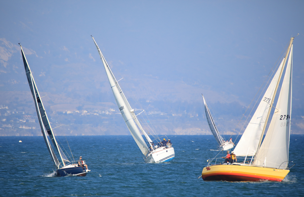 Santa Barbara Yacht Club members charge across the ocean at the charity event.