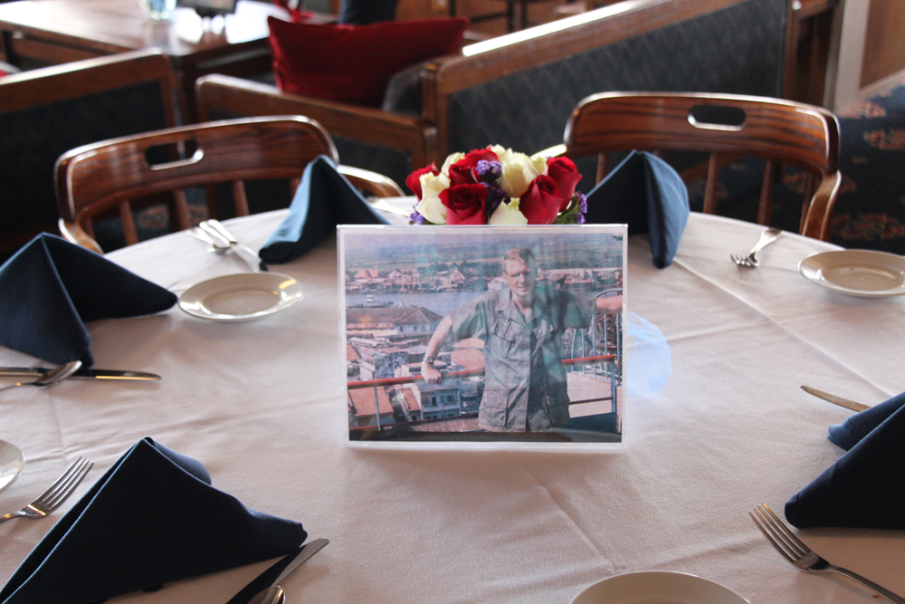 Photos of honored veterans graced the tables.