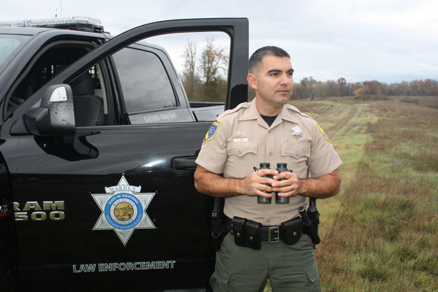 CDFW wildlife officers are fully sworn California peace officers. Warden Jorge Paz is pictured.