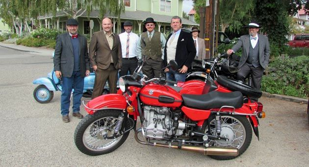 Participants in Sunday's Central Coast segment of the Distinguished Gentleman's Ride stopped for coffee in Los Olivos. Pictured are Kyle Milliken of Oceano, Josh Snow of Santa Maria, Billy Haas of Santa Maria, J.P. Prichard of Los Alamos, Jeff Carroll of Santa Barbara, and Eve and Mike Byrd of Arroyo Grande. (Janene Scully / Noozhawk photo)