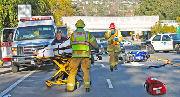 The driver of a Honda motorcycle survived a rear-end crash into a stopped car on West Mission Street in Santa Barbara but his bike looked to be a goner after the wreck. (Urban Hikers photo)
