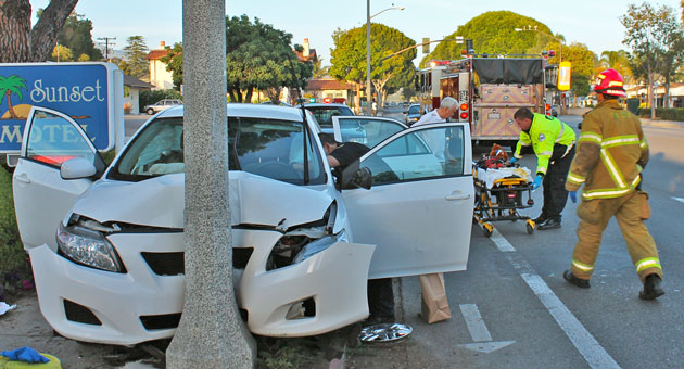 Santa Barbara firefighters and other emergency personnel respond to an apparent DUI crash that left a 3-year-old boy seriously injured. His mother, who was driving the car, was arrested on felony charges. (Urban Hikers photo)
