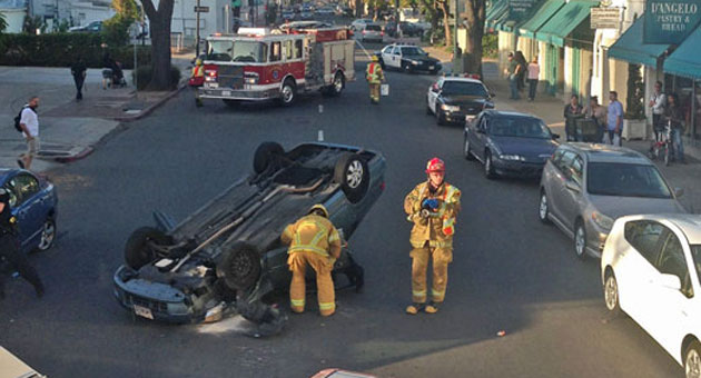 The driver of a Honda civic that overturned June 16 in downtown Santa Barbara was arrested on suspicion of driving while intoxicated, according to Santa Barbara police. (Chris Mailes / Santa Barbara City Fire Department photo)