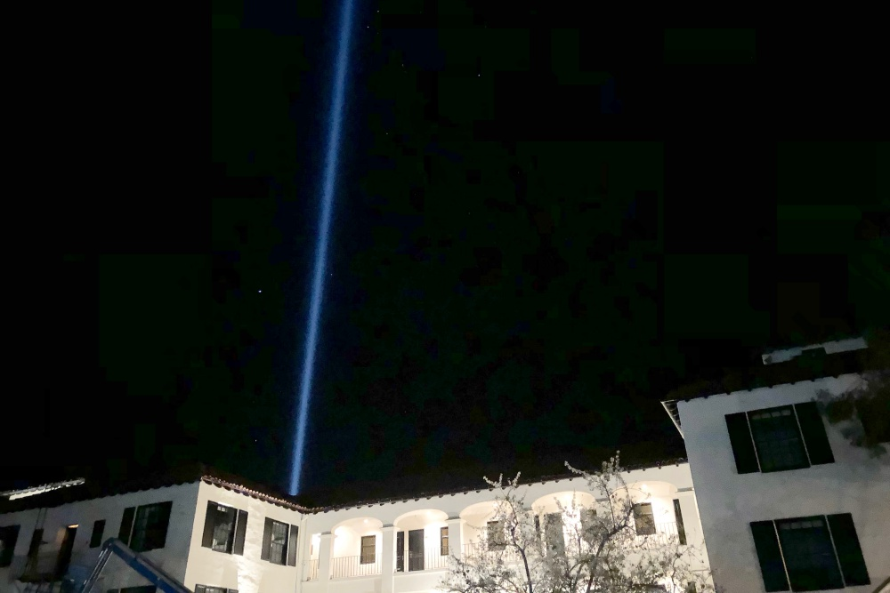 A spotlight pierces the night sky Saturday from the roof of the Montecito Inn, at 1295 Coast Village Road. The spotlight commemorates the 23 people killed or missing in the deadly Jan. 9 flash flooding and mud flows.