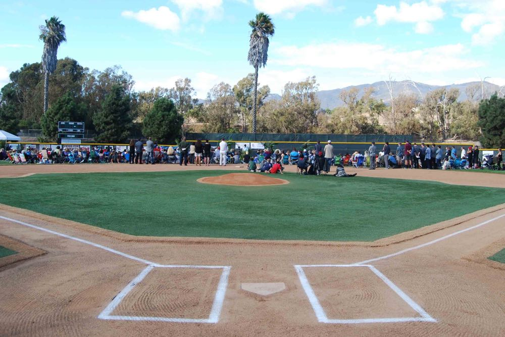 A large crowd gathered on one of the baseball fields at the Goleta Valley South Little League complex to celebrate the life of youth baseball coach Andrew Darke, who died Sept. 26 at age 51.