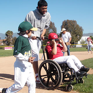 Diego rides along the bases during a game last year in the Dos Pueblos Little League's Challenger Division.