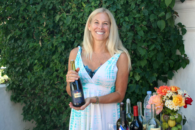 Online wine seller Teri Love of Gioia Wine at her favorite booth location for the annual Santa Barbara Wine Festival at the Santa Barbara Museum of Natural History.