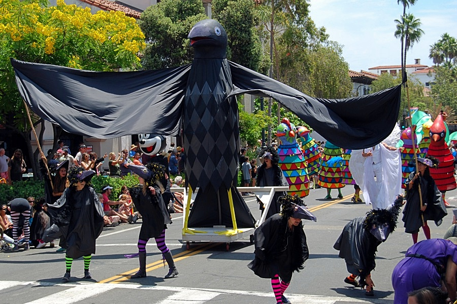 In a bit of a departure from the colorful costumes of Santa Barbara's annual Summer Solstice Celebration, a flock of birds goes black and forth on State Street.