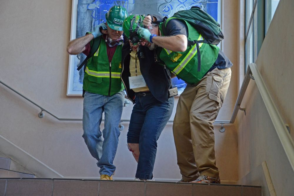 "Santa Barbara Community Emergency Response Team volunteers tend to a ""victim"" during an earthquake response drill."