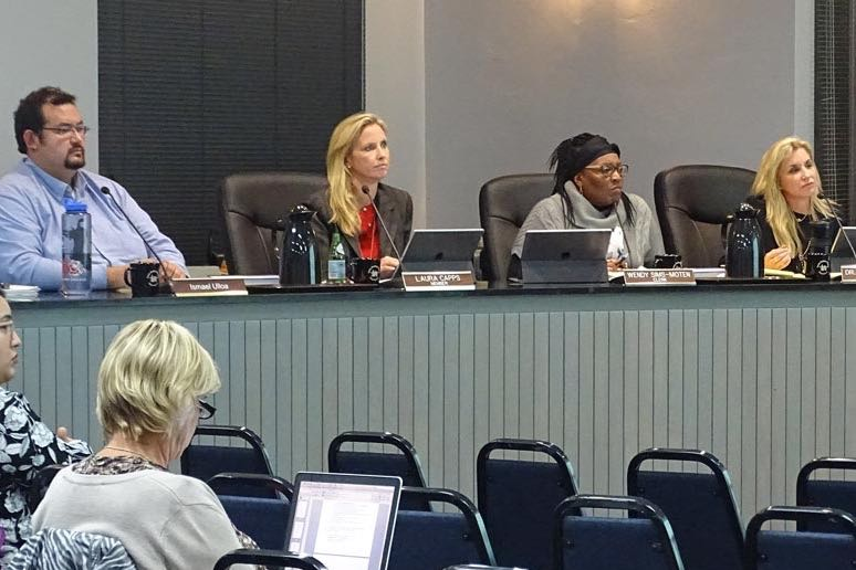 New Santa Barbara Unified School District trustees, from left, Ismael Ulloa, Laura Capps, Wendy Sims-Moten and Jackie Reid listen to a presentation at last week's school board meeting.