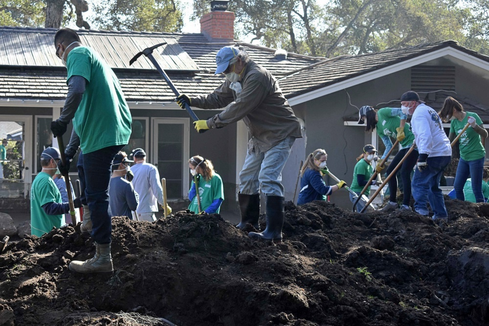 Volunteers from Habitat for Humanity of Southern Santa Barbara County usually build houses. These days in Montecito, they're helping to excavate them.