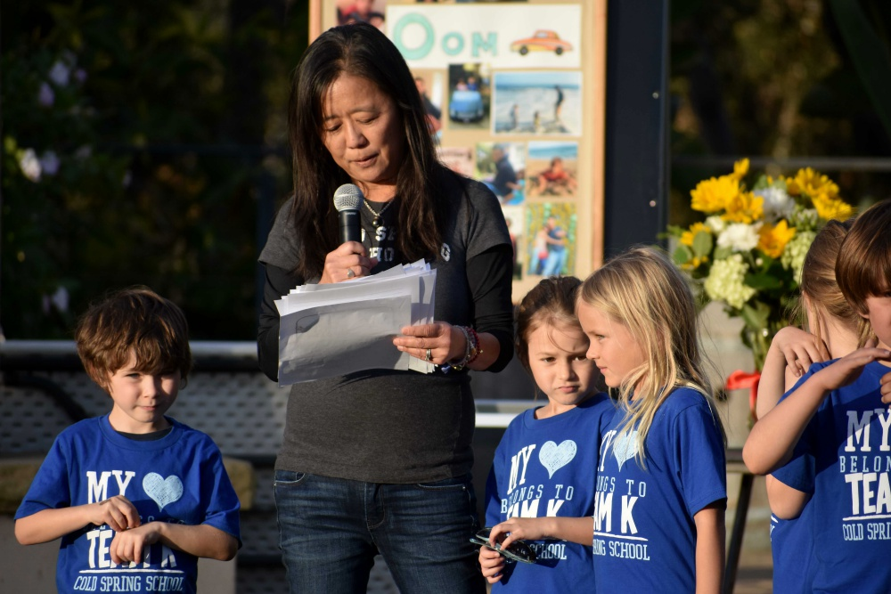 "Cold Spring School kindergarten teacher Lisa Ishikawa reads a tribute to 6-year-old Peerawat ""Pasta"" Sutthithepa, a student of hers who was one of four family members to perish in the deadly Jan. 9 flash flooding and mud flows in Montecito. Afterward, she and Pasta's classmates sang a song in his honor."