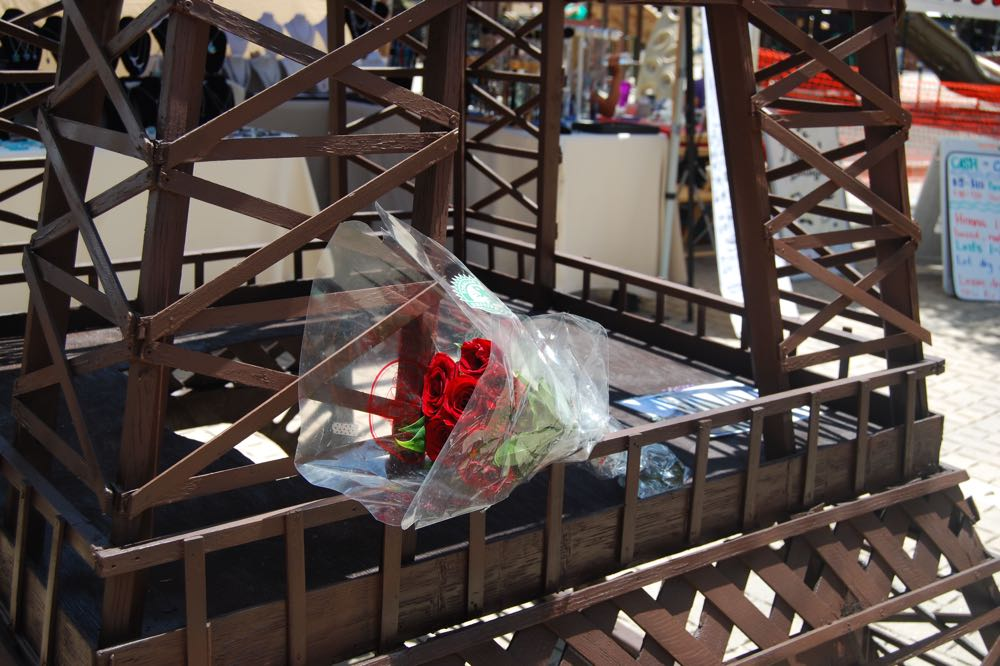 Roses placed on a replica Eiffel Tower at the 28th annual Santa Barbara French Festival were a somber reminder of the apparent Islamic terrorist attack in Nice.