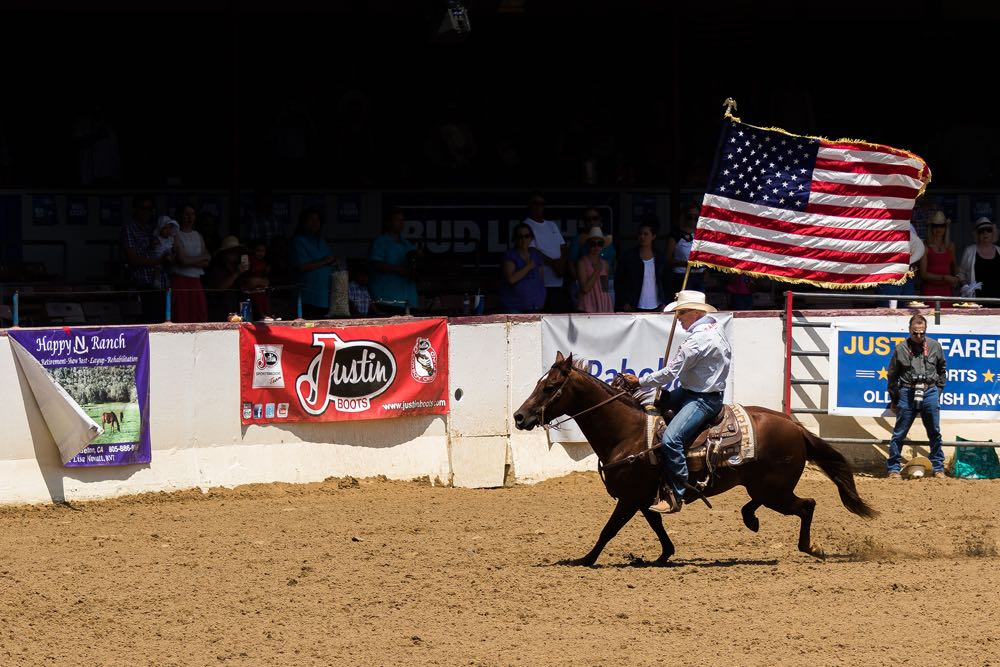 A rider racing around the rodeo arena with an American flag heraldis the start of the 92nd annual Old Spanish Days Fiesta Stock Horse Show & Rodeo.