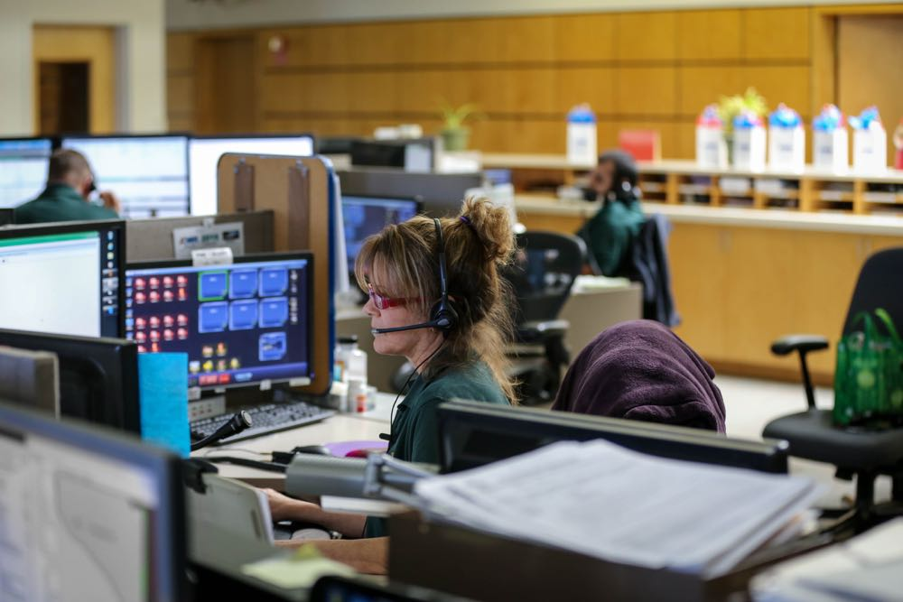 Jill Steinmetz handles a 9-1-1 call at the Santa Barbara County Sheriff's Department emergency dispatch center. Calls from landline telephones go directly to the center but cellphone calls are transferred from the California Highway Patrol's own dispatch operation.