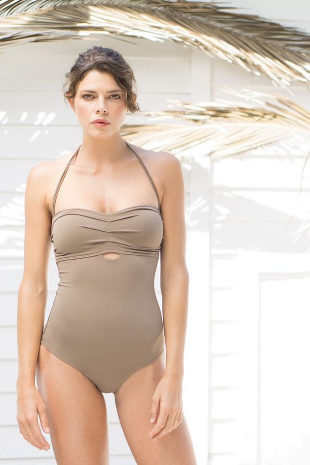 Model Tiana Geifer sports a So De Mel beige one-piece swimsuit.