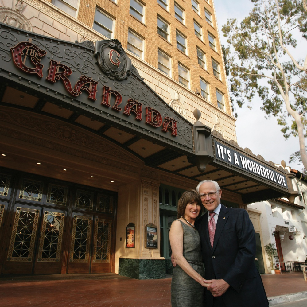 Michael Towbes, with wife Anne Smith Towbes, outside Santa Barbara's landmark Granada Theatre he did so much to help restore. (Santa Barbara Center for the Performing Arts photo)