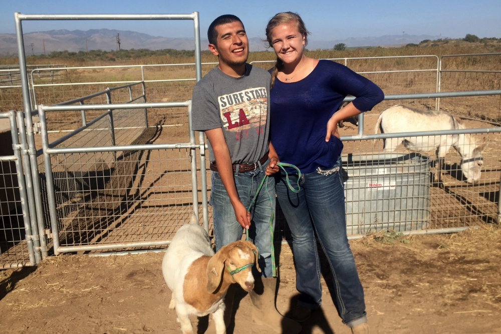 Righetti High School special education student Freddie Castaneda and Warrior Goat Program mentor Brooke Minetti get a photo opportunity with the goat they raised together to show at the 2016 Santa Barbara County Fair.