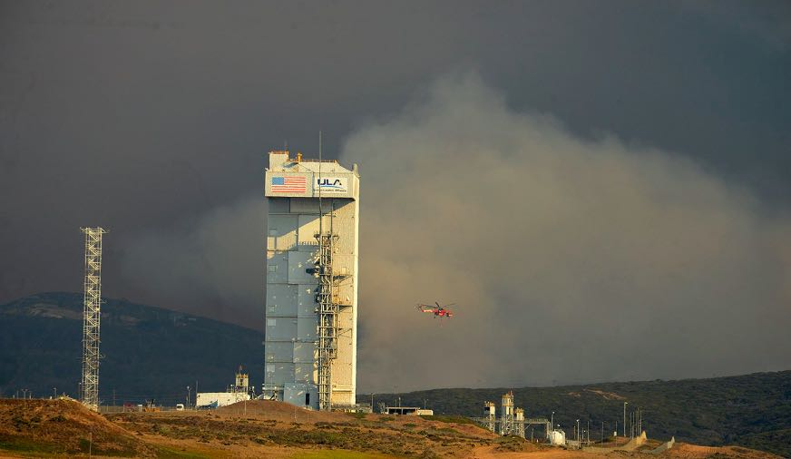 The Canyon Fire burns beyond Vandenberg Air Force Base's Space Launch Complex-3, which has an Atlas V rocket buttoned up inside. The rocket's Sunday launch was postponed because of the wildfire.