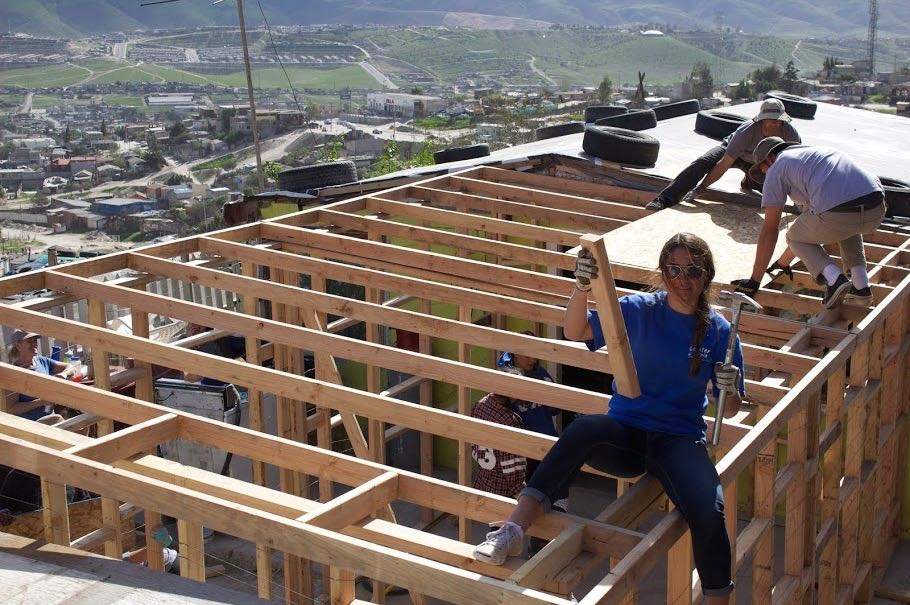 As the framing nears completion, one student celebrates her board-certification.