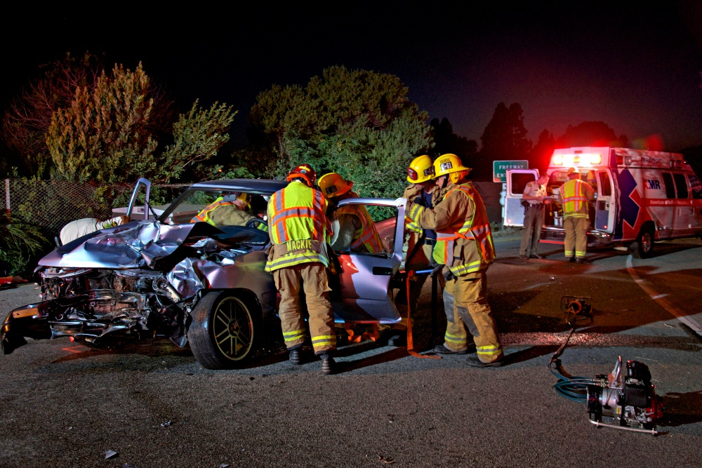 Carpinteria-Summerland firefighters prepare to move a car crash victim to a back board at the scene of a recent wreck.