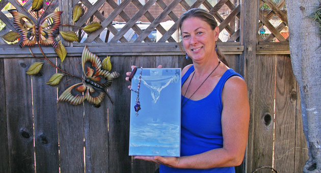 Janet Carroll's painting of Jesus Christ on the cross was a favorite of her housemate, Allison Meadows, who was killed in a 2012 car-surfing incident.  (Tom Bolton / Noozhawk photo)