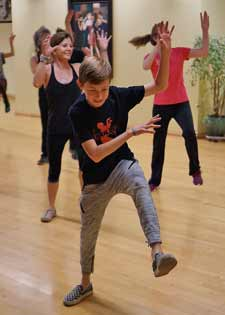 Local zombies work on dance moves in preparation for Oct. 27 Thrill the World performance at Courthouse Sunken Garden.