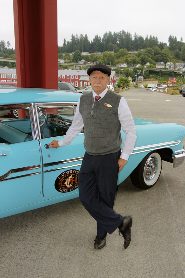 Spence with the Cannery Pier Hotel's classic Chevy.