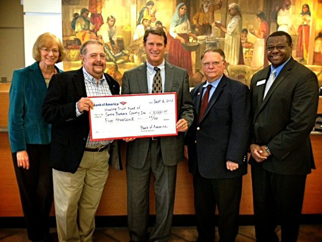 The Bank of America Charitable Foundation presents the Housing Trust Fund of Santa Barbara County with a $5,000 grant award. Pictured from left are Jennifer McGovern, president/CEO of the Housing Trust Fund; Roger Horton, chairman of the board for the Housing Trust Fund; David Prichard, senior vice president/Santa Barbara market president for Bank of America; DeWayne Holmdahl, board member for the Housing Trust Fund; and Melvin Fountain, banking center manager for Bank of America's Santa Barbara main branch. (Housing Trust Fund of Santa Barbara County photo)