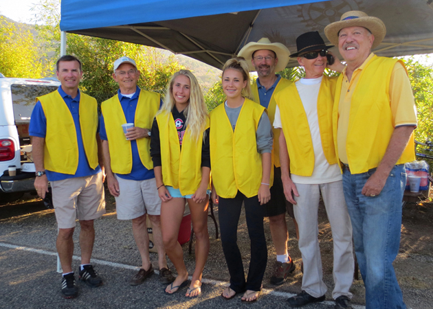 <p>Rotary Club of Carpinteria volunteers Dave Durflinger, from left, Harry Harper, Erin and Megan Durflinger, Michael Ensign, Scott Ellinwood and Lin Graf stand by Sunday to assist the competitors in the city&#8217;s triathlon.</p>