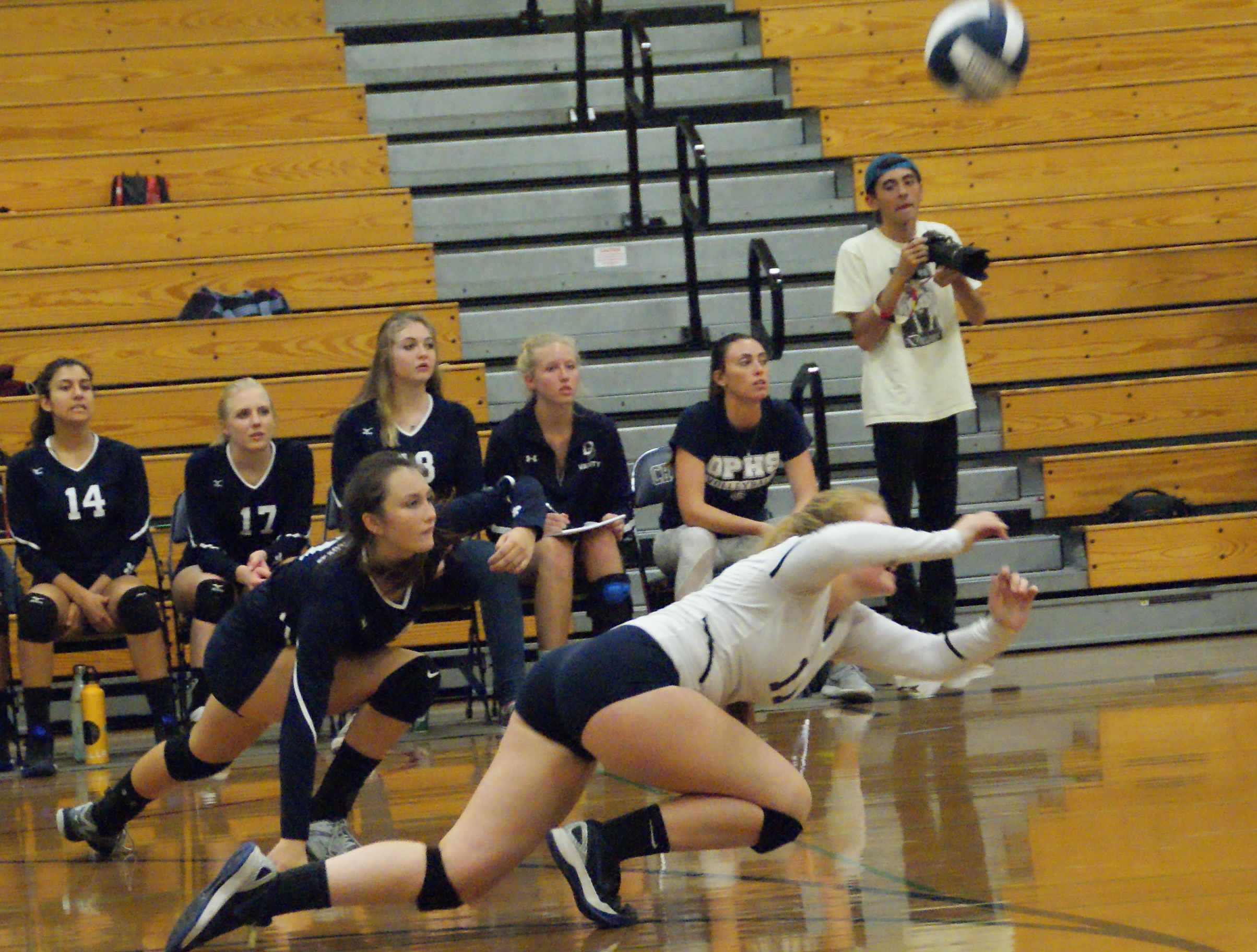 Alison Minnich scrambles on the floor to make one of her 32 digs for Dos Pueblos in a five-set win over Santa Barbara. Also going to the floor is Olivia Andrews.