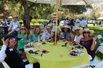 Partygoers enjoy cool beverages and a tasty barbecue after riding and hiking through Montecito trails earlier in the day.