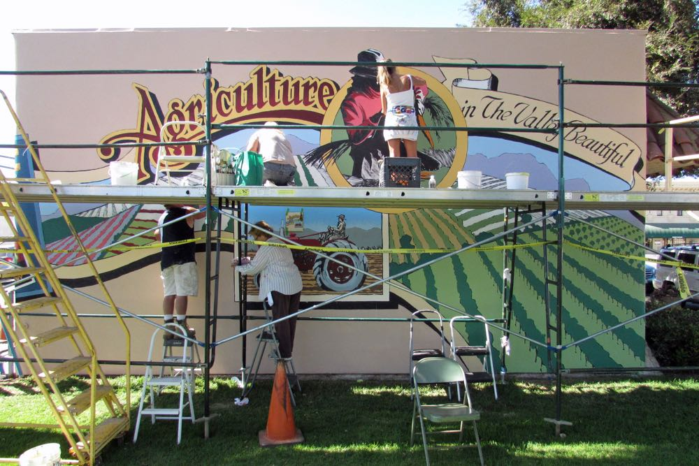 Volunteers paint the newest big art added to Lompoc's inventory through the Mural in a Weekend event Saturday.