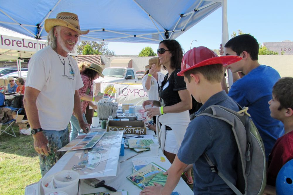 Master artist Art Mortimer talks to volunteer painters during Lompoc's Mural in a Weekend project Saturday.
