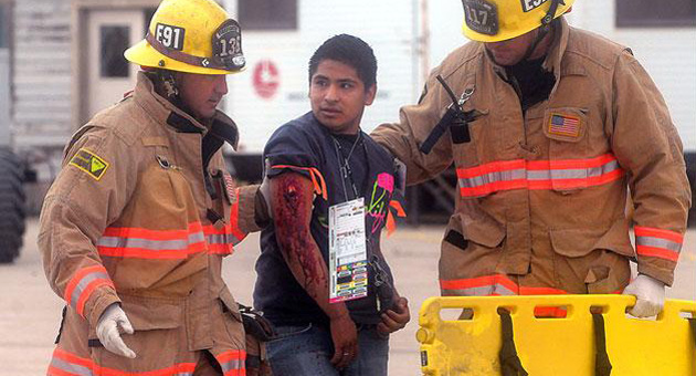 <p>Firefighters help a &#8220;victim&#8221; during a large-scale emergency drill Wednesday at the Santa Barbara Airport.</p>
